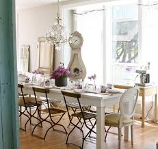 long crystal chandelier dining room transitional with flowers