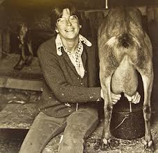 Sherry Thomas  one of the original Country Women Magazine founders  milks a goat on