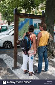 Como Italy Map by Tourists Looking At Map In Bellagio Lake Como Italy Stock Photo