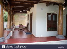 table for two in airy verandah encircling keralite bungalow styled