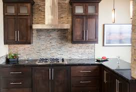 Dark Stained Kitchen Cabinets Dark Stained Cabinetry With Glass And Stone Mosaic Backsplash And