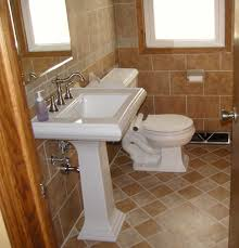 elegant white porcelain pedestal sink and white toilet on diagonal