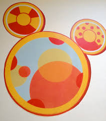 mickey mouse toodles had a table set up with crayons and