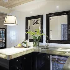 kitchen wet bar with antiqued mirrored backsplash and round sink