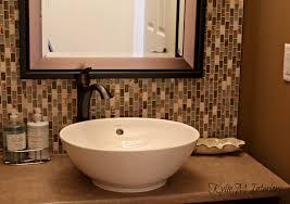 powder room bathroom with full height glass mosaic tile backsplash