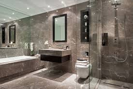 a muted marble bathroom with dark oak inset storage and walk in