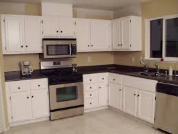brilliant brown finished kitchen cabinets also marble countertops