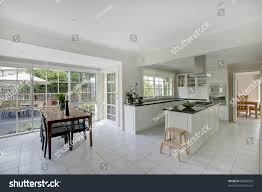 a modern combined kitchen and dining room stock photo 69068005