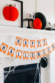happy halloween banner free printable how to style a traditional halloween mantel the tomkat studio