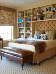 elegant tufted headboard and stylish built in wall shelves for