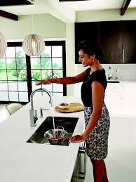 why touch your kitchen faucet when you don u0027t have to moen expands
