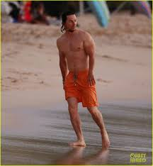 mark wahlberg is so ripped on the beach in barbados photo
