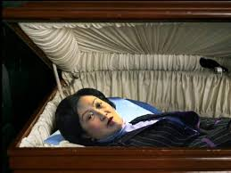Death Becomes Her  Regina Ip squeezes into      coffin homes       gets
