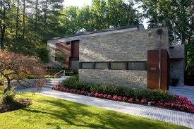 Stone Cladding For Garden Walls by Narofsky Architecture