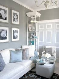 living room gray recliners white shelves gray sofa brown chairs