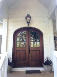 front door arch window treatments arched frame brown glass white