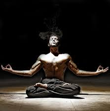 A man posing in a lotus position