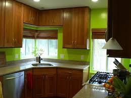 sage green vintage kitchen cabinets with wooden countertop also