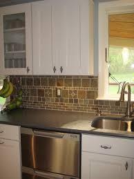 white cabinets dark countertops and slate backsplash kitchen