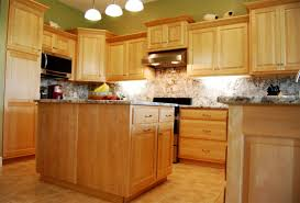 large kitchen with an island and wooden light maple cabinets