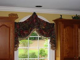 bold floral curtain window treatment for small arched window