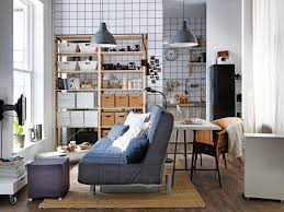 small space living room bookshelf between couch and door for end