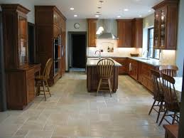 tuscan kitchen style designed with travertine floors and using