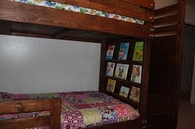 ana white bunkbed with bookshelves stairs and storage bins