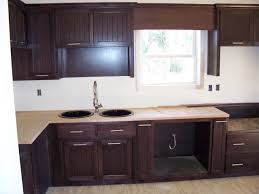 sectional black beadboard kitchen cabinets on white stucco wall