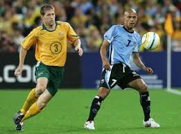 Scott Chipperfield puts pressure on Gustavo Varela of Uruguay during the second leg of the World Cup qualifying match between Australia and Uruguay. - chipper_gallery__470x347