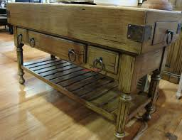 double butcher block island in antique oak with wrought iron