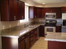 granite countertop black kitchen cabinets with white appliances
