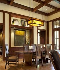 dining room with wooden table and chairs also hanging mission