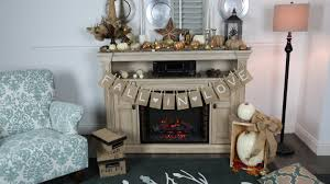 rustic light grey wooden stand alone fireplace with thanksgiving