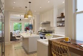 white kitchen cabinets with dark floors large refrigerator mix