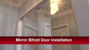 Bifold Closet Door Locks by Mirror Bifold Door Installation Youtube