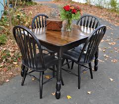 heir and space vintage oak and maple dining set in distressed black i sanded stained and sealed the top which has a clever hidden interior leaf and painted the chairs and base in a satin black distressed for a relaxed