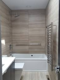 large striated tiles heated towel bar recessed shampoo niche