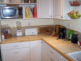 ceramic countertop on white kitchen cabinet with hanging cabinet
