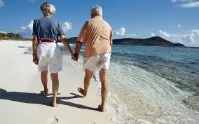OLD COUPLE ON A BEACH