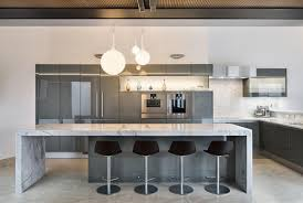 Poggenpohl Kitchen Cabinets Gunmetal Gray Along With Carrera Marble Make This Modern Kitchen