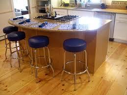 kitchen island wide pine floors blue stools countertop overhang