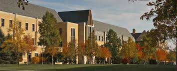 An exterior of the Mendoza College of Business in the Fall University of Notre Dame