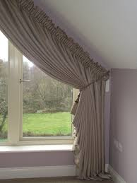 shaped curtains on a triangular window made by ger u0027s curtains