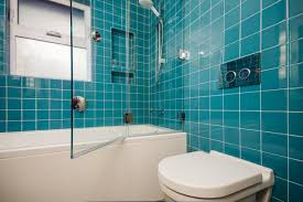 glass enclosed shower with bold teal tiles this modern bathroom 20 functional stylish bathroom tile ideas