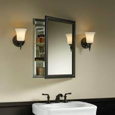bathroom lighting over surface mount medicine cabinet u2022 bathroom