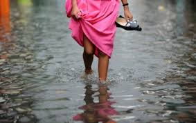 image of a woman walking in the flood