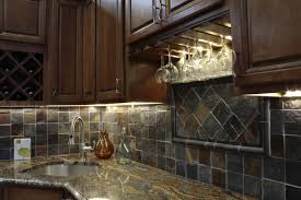 terrific dark stones backsplash and corner bowl sink under dark