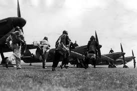 Spitfire pilots racing to their aircraft during a scramble - a mad dash to get airborne to catch an incoming raid.