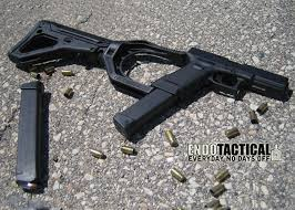 Liste des répliques - Partie II, les pistolets-mitrailleurs [Achevée] Endotac_glockadaptor